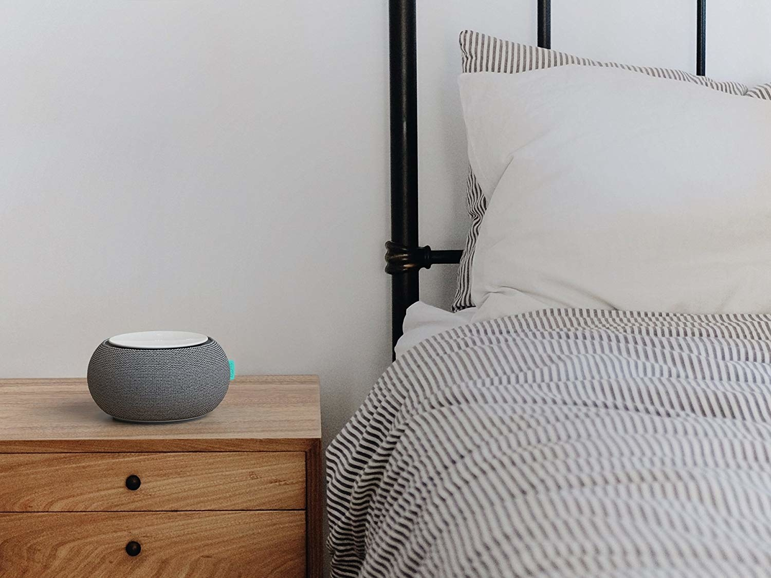 Small round device next to bed