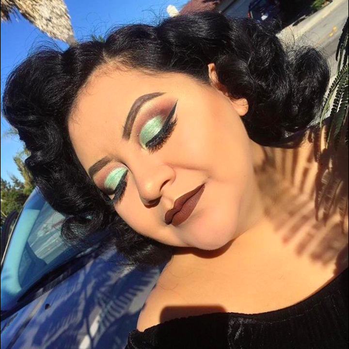 A reviewer wearing the powder as part of their flawless dramatic makeup look