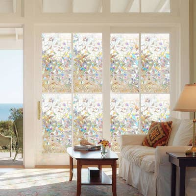 The decorative window film on a set of eight windows in a room