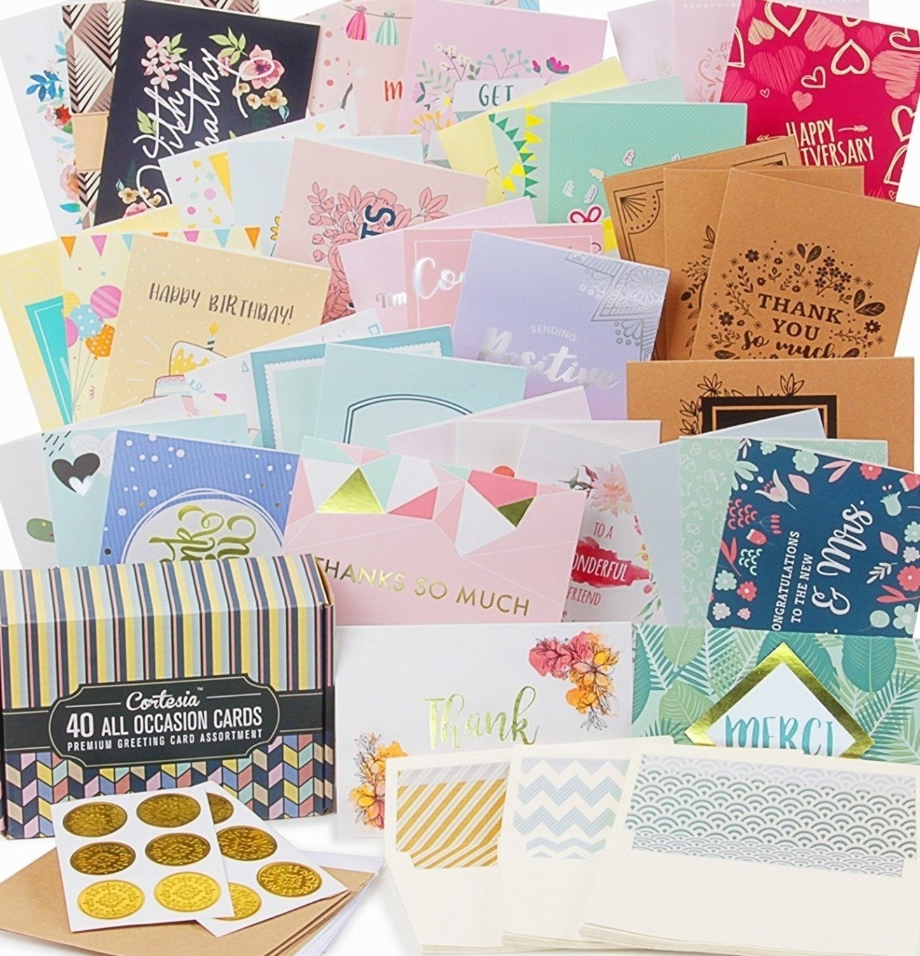 The collection of birthday cards spread out showing the different variety