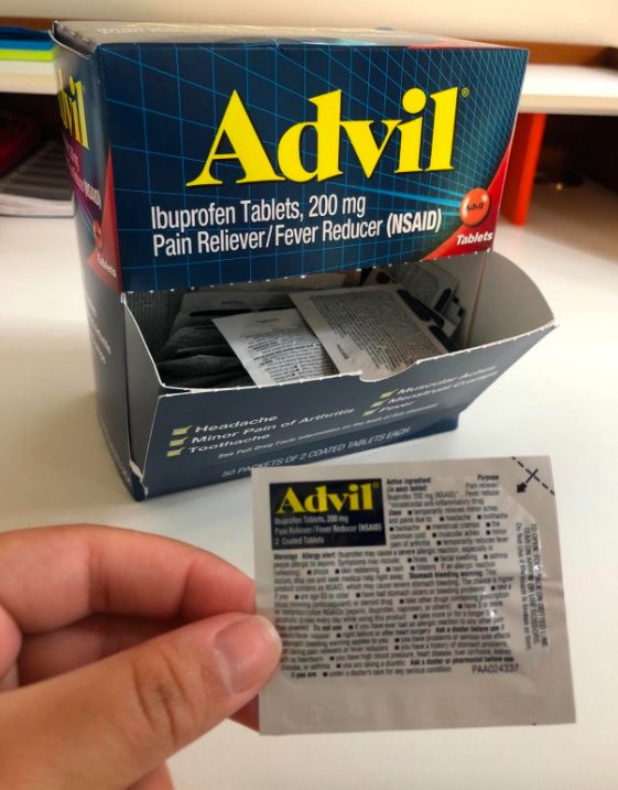 Reviewer holding one of the Advil packets