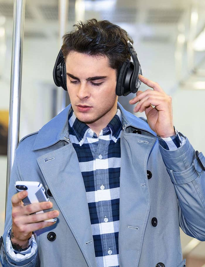 A model wearing the headphones