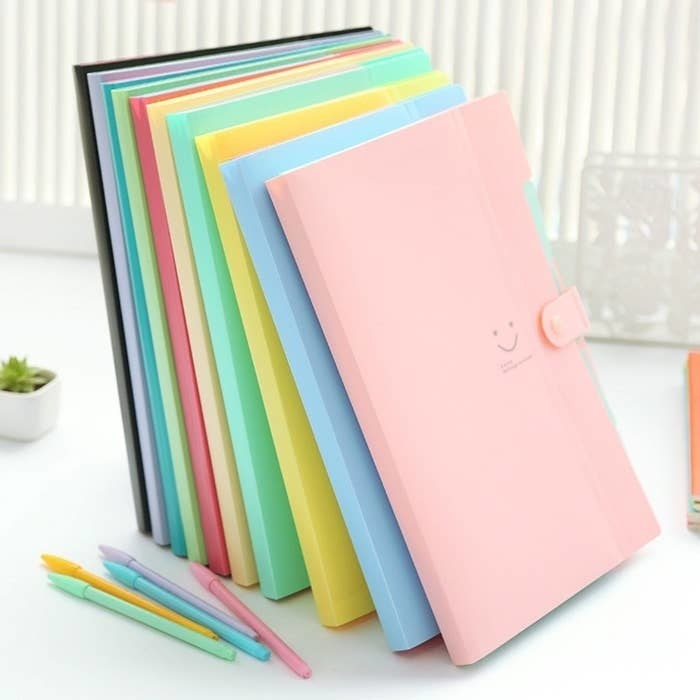 Pastel folders with a snap closure in pink, blue, yellow, green, and more