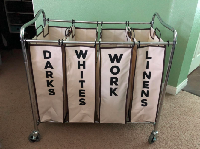 """a reviewer photo of the cart broken into four sections, """"darks, whites, work, and linens"""""""