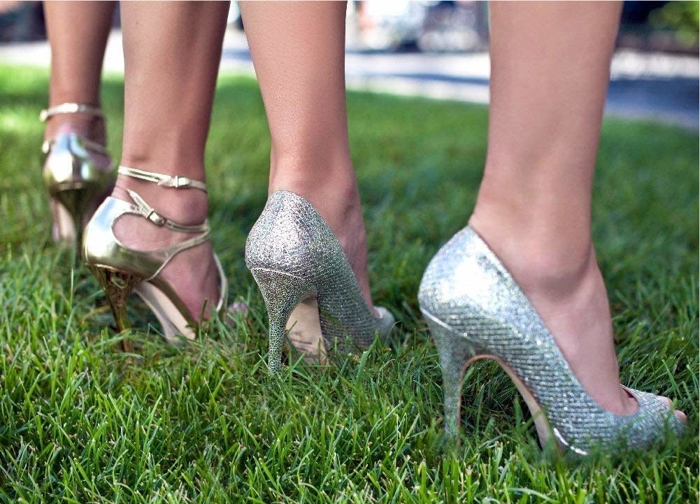 A group of people wearing highheels in grass