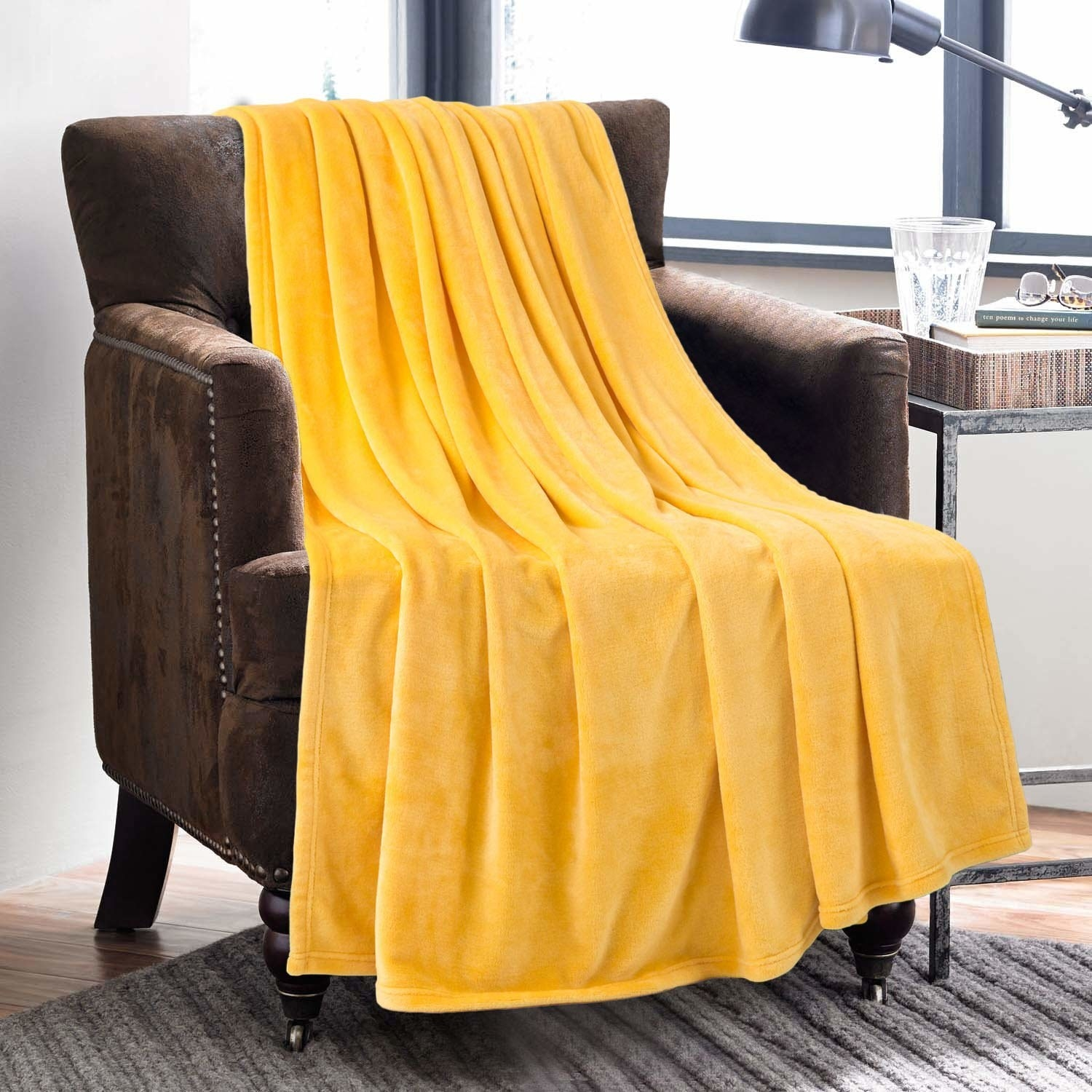 The throw in yellow draped over an armchair