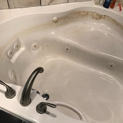 Same reviewer's hot tub with the water removed and a ring of dirt around the edge of the tub