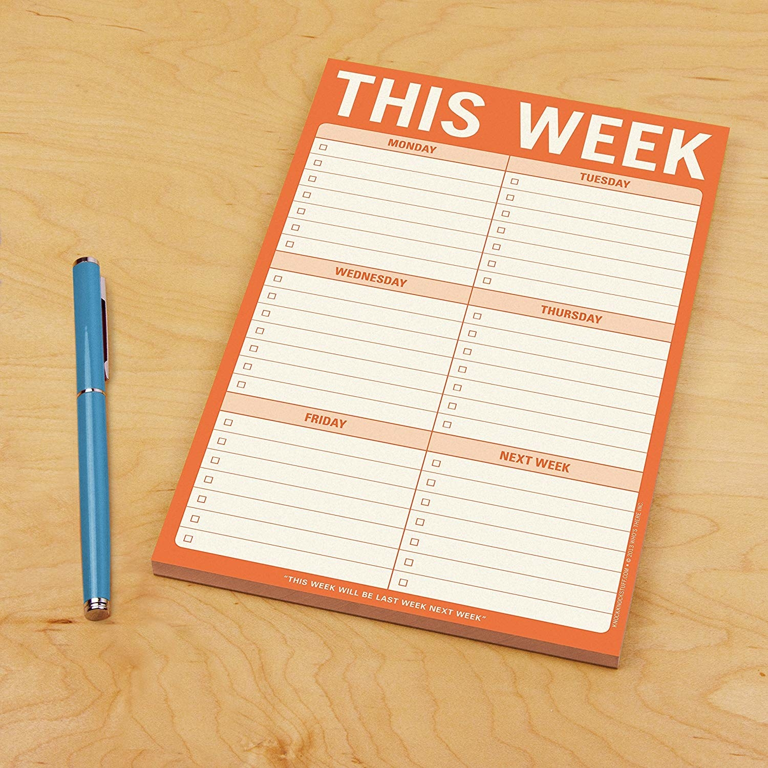 The notepad with lines for writing tasks for monday-friday and next week