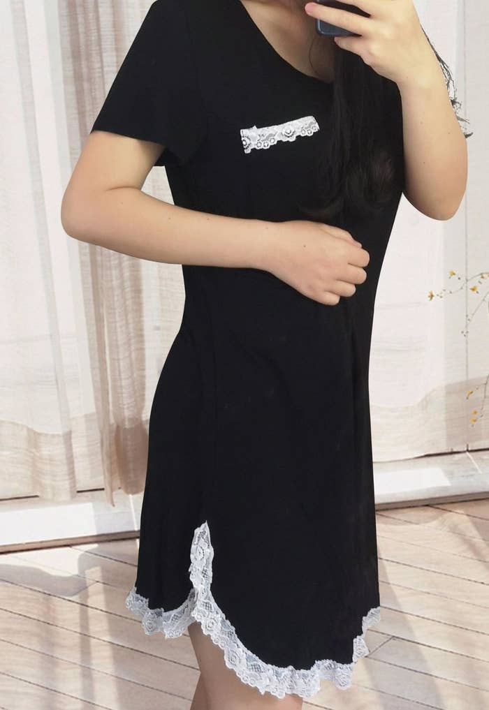 model in black t-shirt nightgown with white lace trim and a chest pocket