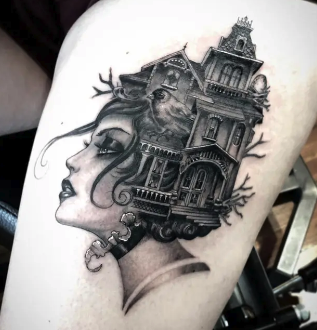 A tattoo of a woman's head with a house coming out of her hair