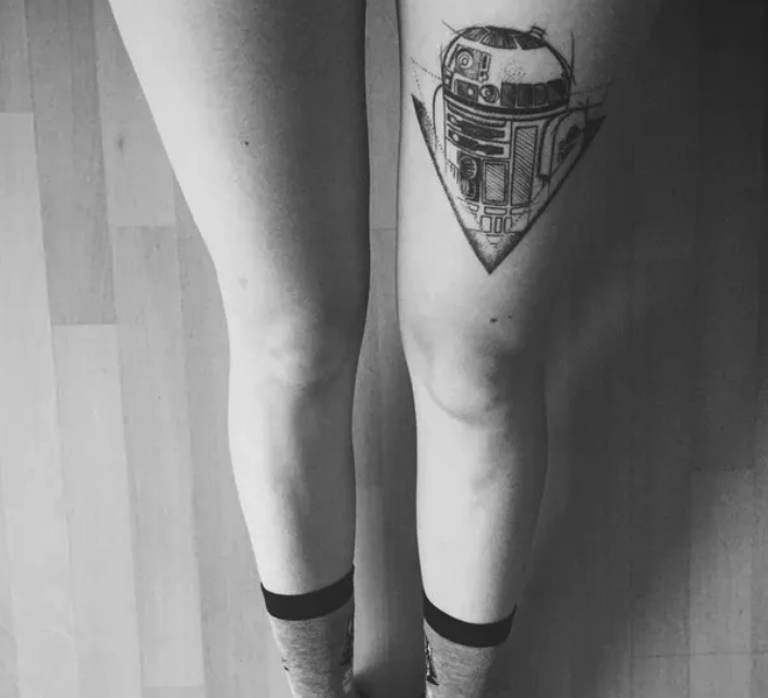 A thigh tattoo of R2-D2