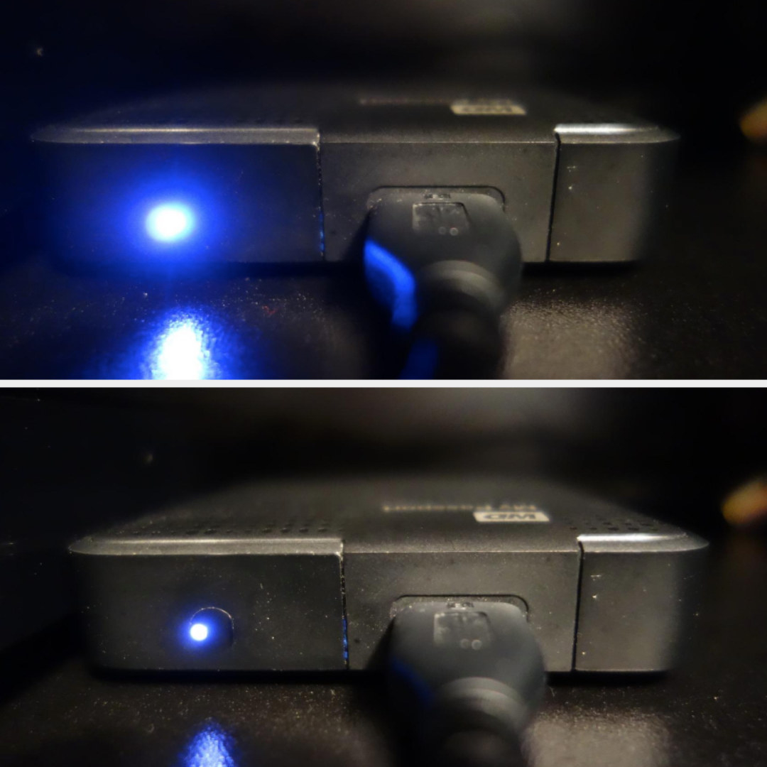 On the top, a blue light from a router shining pretty bright, and on the bottom, the same light now more dimmed after the sticker is over it