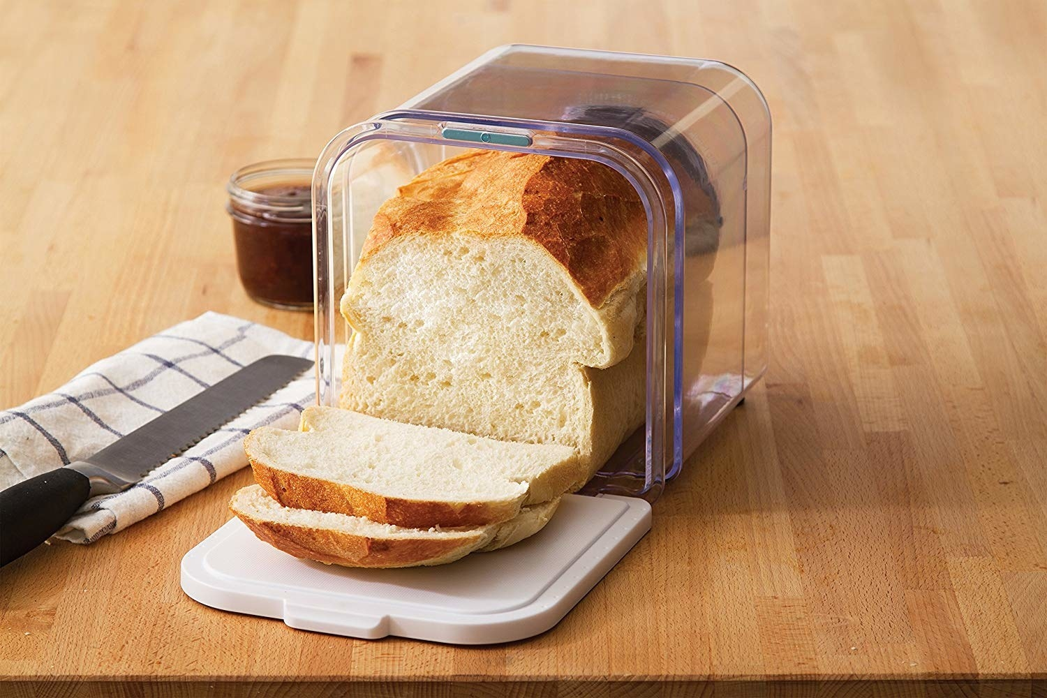 A loaf of bread in a collapsable bread box