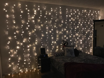 twinkle lights layered down the walls of a reviewer's bedroom