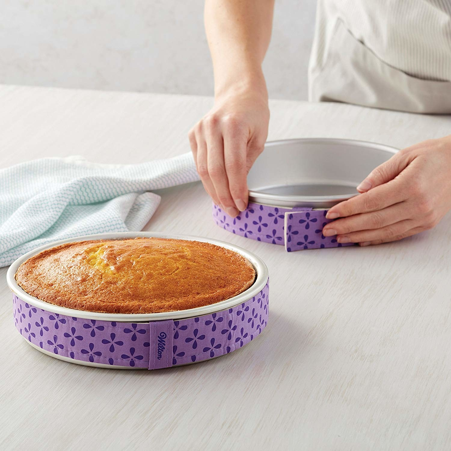 Cake pans wrapped with the fabric strips