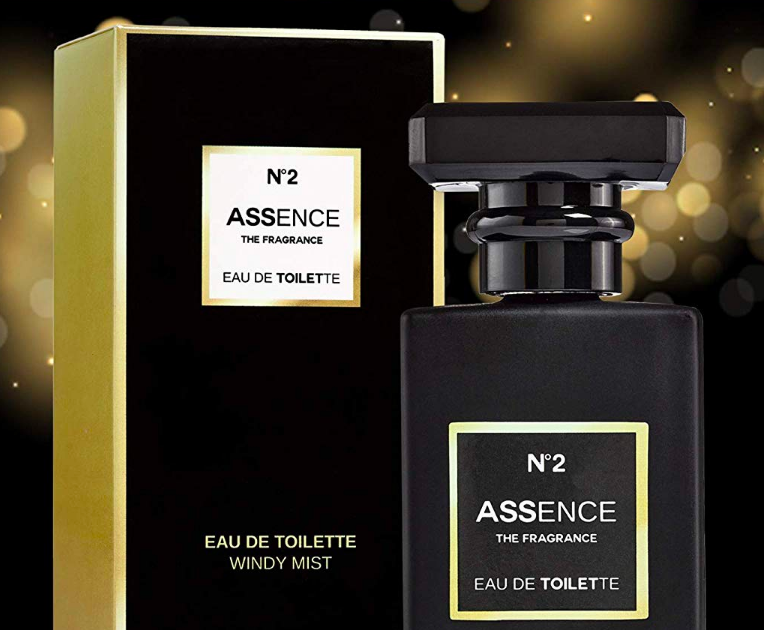Fancy looking bottle of perfume beside packaging