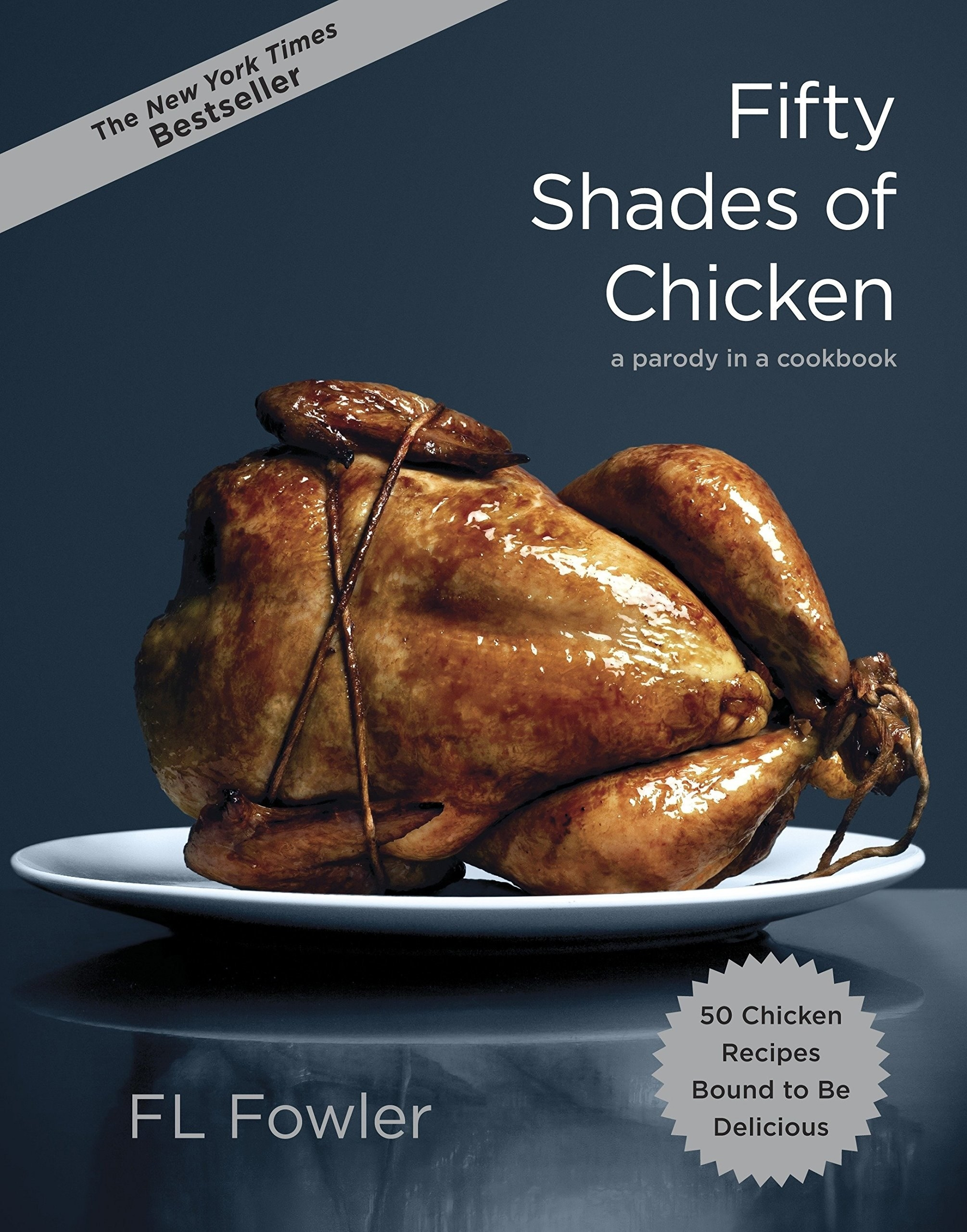 Book cover with bound, cooked chicken on a plate