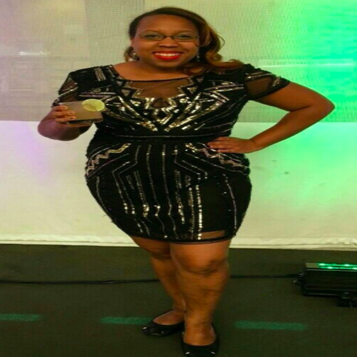 A reviewer wearing the black short sleeve dress with silver beading