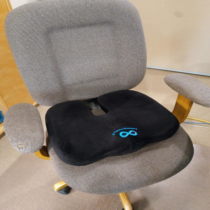 Reviewer's seat cushion on a desk chair