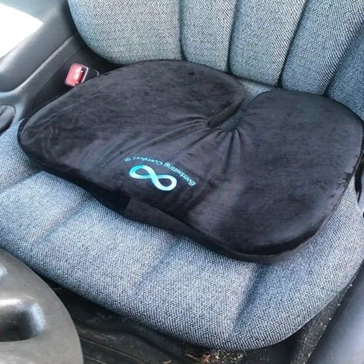 Reviewer's seat cushion on a car seat