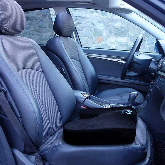 Memory foam seat cushion placed on a car seat