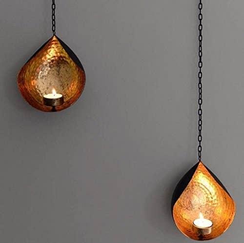 Metallic hanging candle holders.