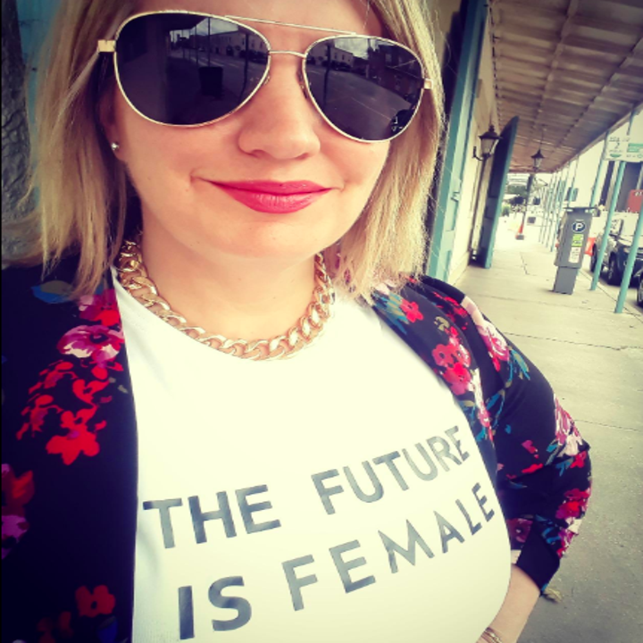 """A reviewer wearing the tee that reads """"The future is female"""" in white"""