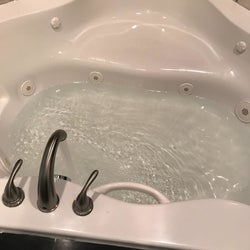 Same reviewer's jetted tub with clean water and a sparkly exterior