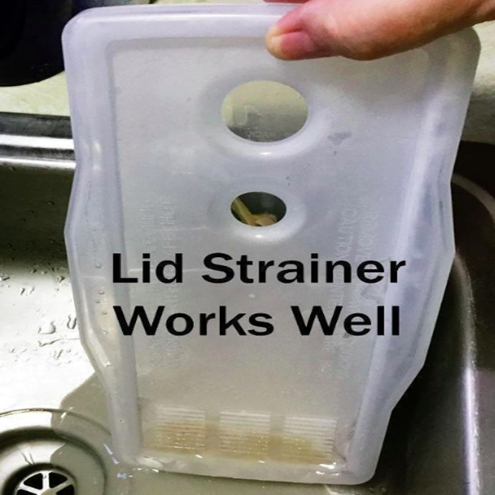 """Reviewer image of the pasta maker with the caption """"lid strainer works well"""""""