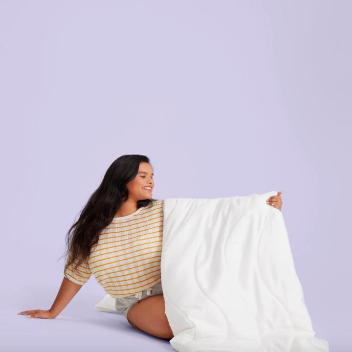 Model under the comforter
