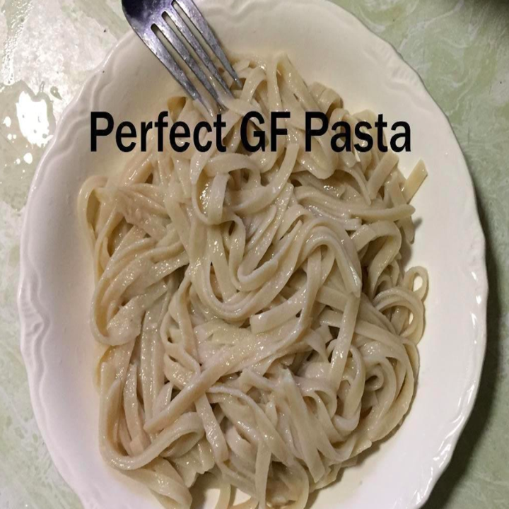 """Reviewer image of a plate of pasta with the caption """"perfect GF pasta"""""""