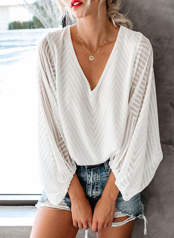Model wearing the flowy top in white