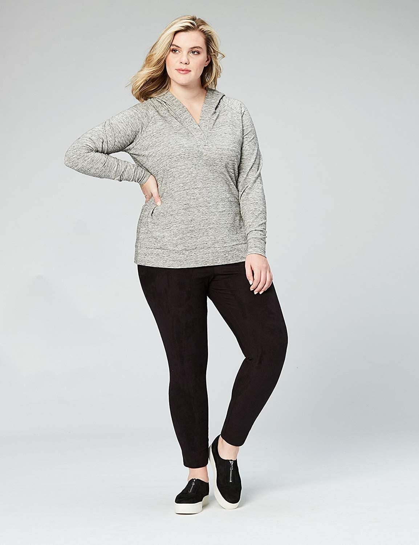 model wears sweatshirt with kangaroo pouch