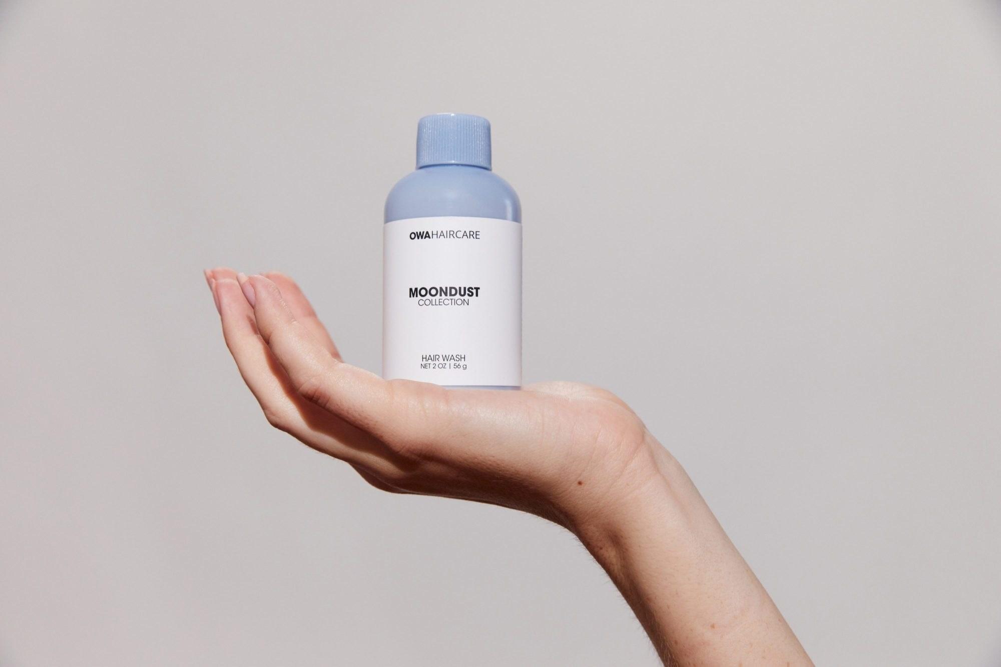 hand holds small plastic bottle