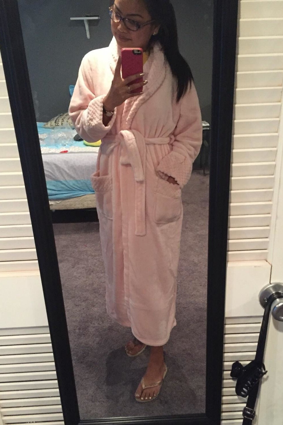 reviewer in long pink robe