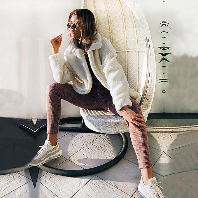 Model wearing fluffy fleece jacket with leggings