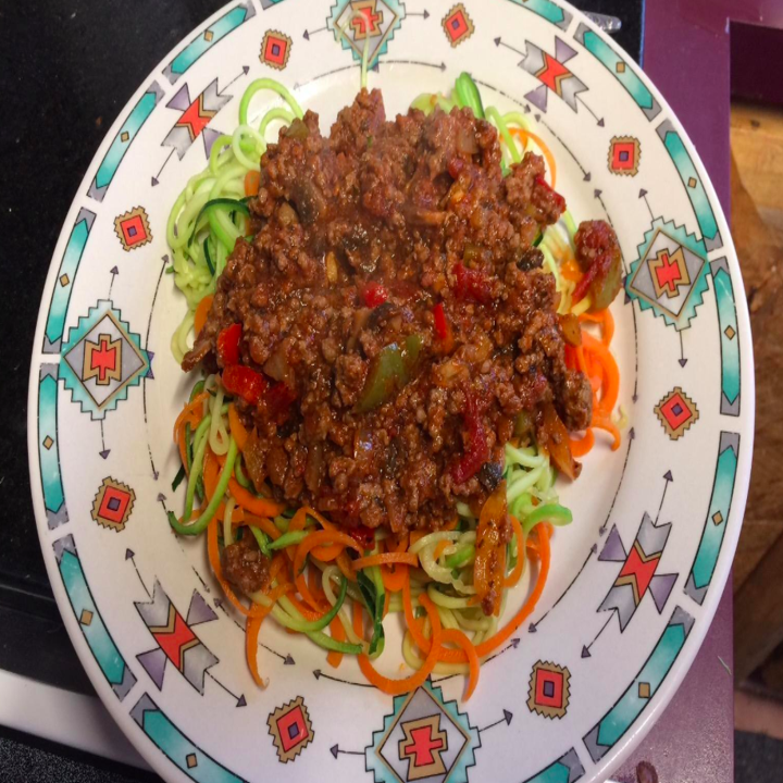 Reviewer image of a plate of food garnished with thinly shredded veggies