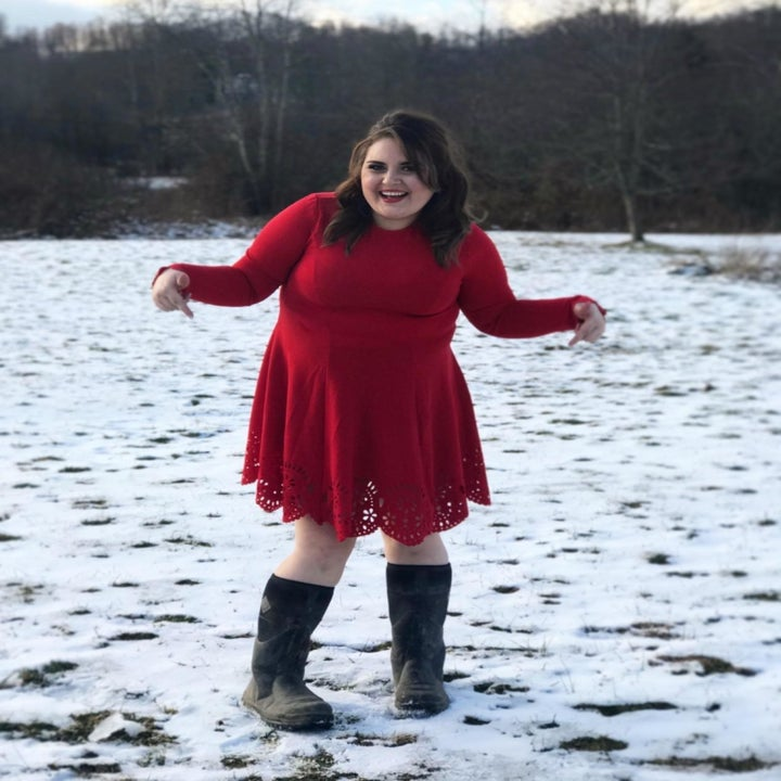 A different reviewer wearing the dress in red