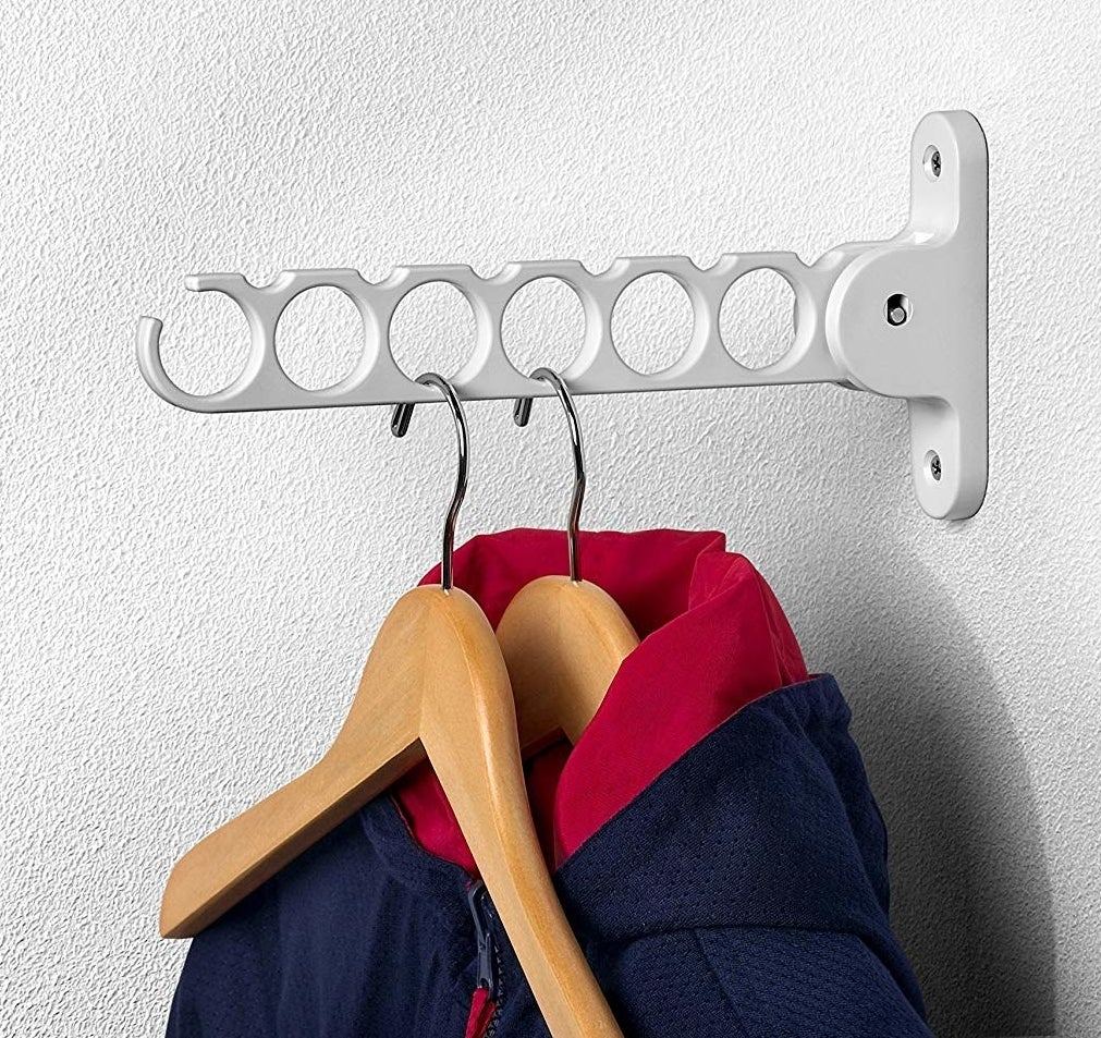 Two hangers hanging from the hanger holder