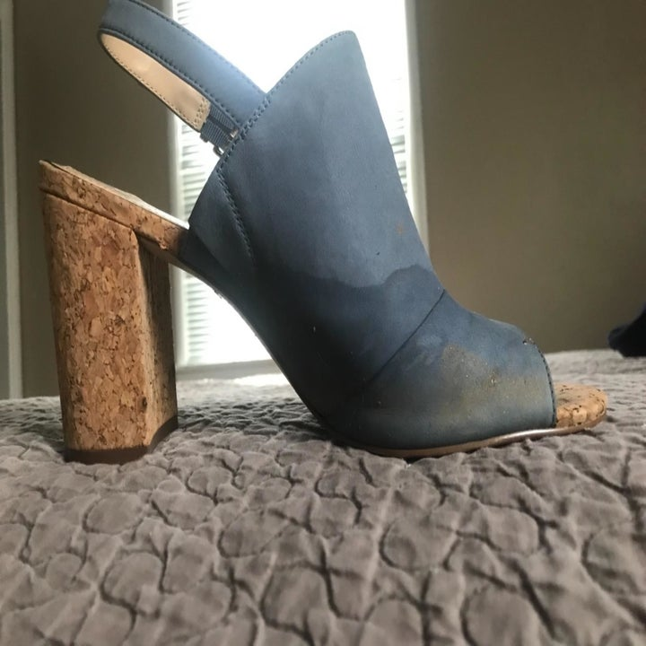 Before photo of blue suede heels with watermarks and stains around the toe