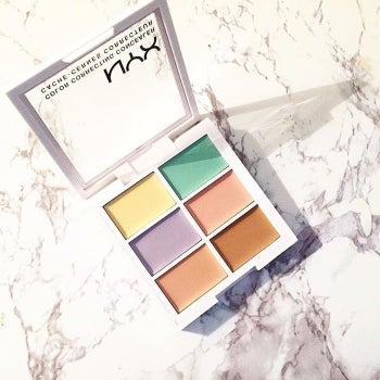 The palette with yellow, green, purple, peach, pink, and brown color correctors