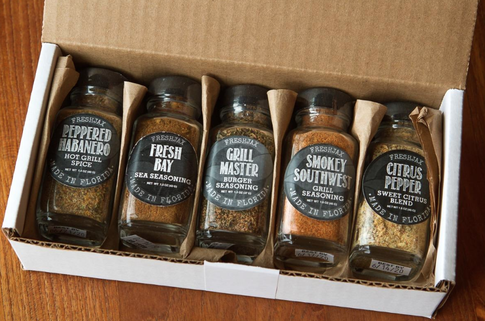 Reviewer image of the spice set opened up with five different spice flavors