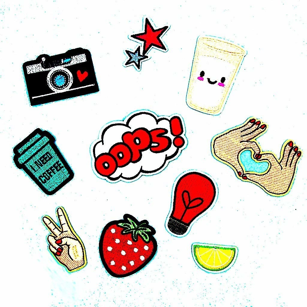 Colourful cloth patches in varying designs. There's a strawberry cloth patch, a lemon wedge one, camera one, and many more.