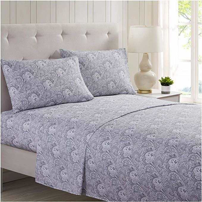 Paisley patterned sheets on a bed