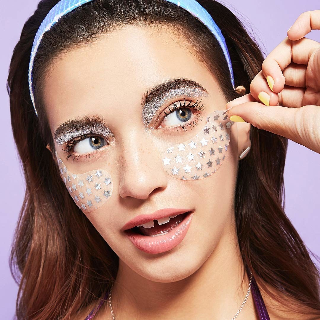 model using eye masks with silver stars