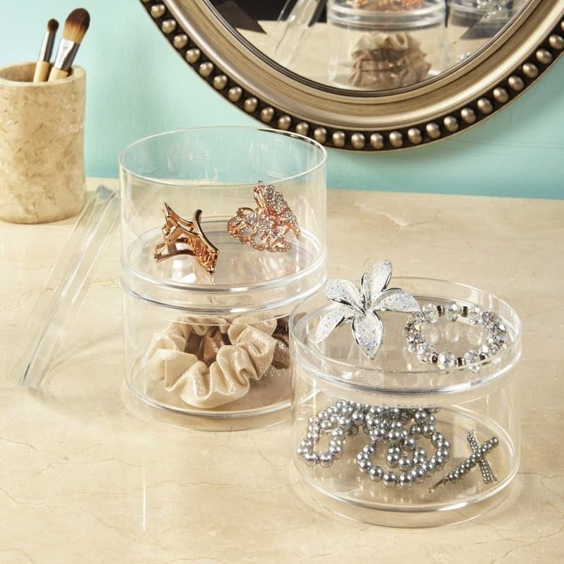the clear stackable containers filled with hair accessories and jewelry