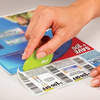 Hand using slicer to cut coupons