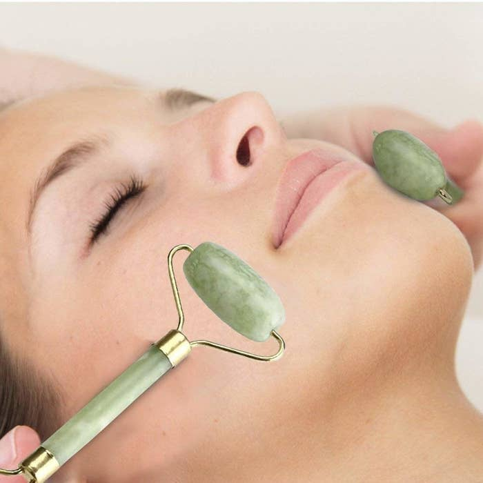 A woman using the jade roller.