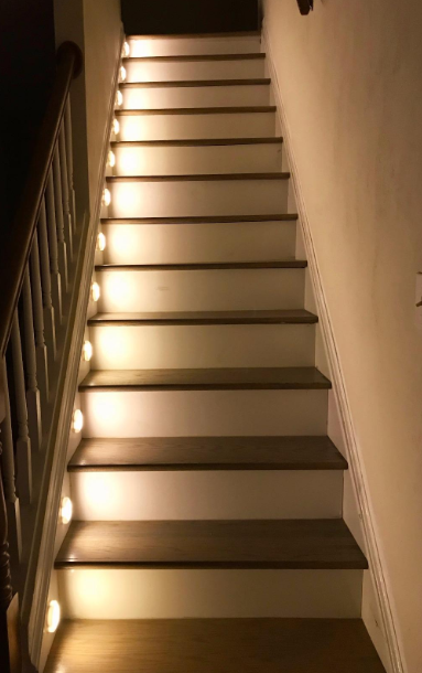 A staircase with the lights lining it making it easier to get up and down
