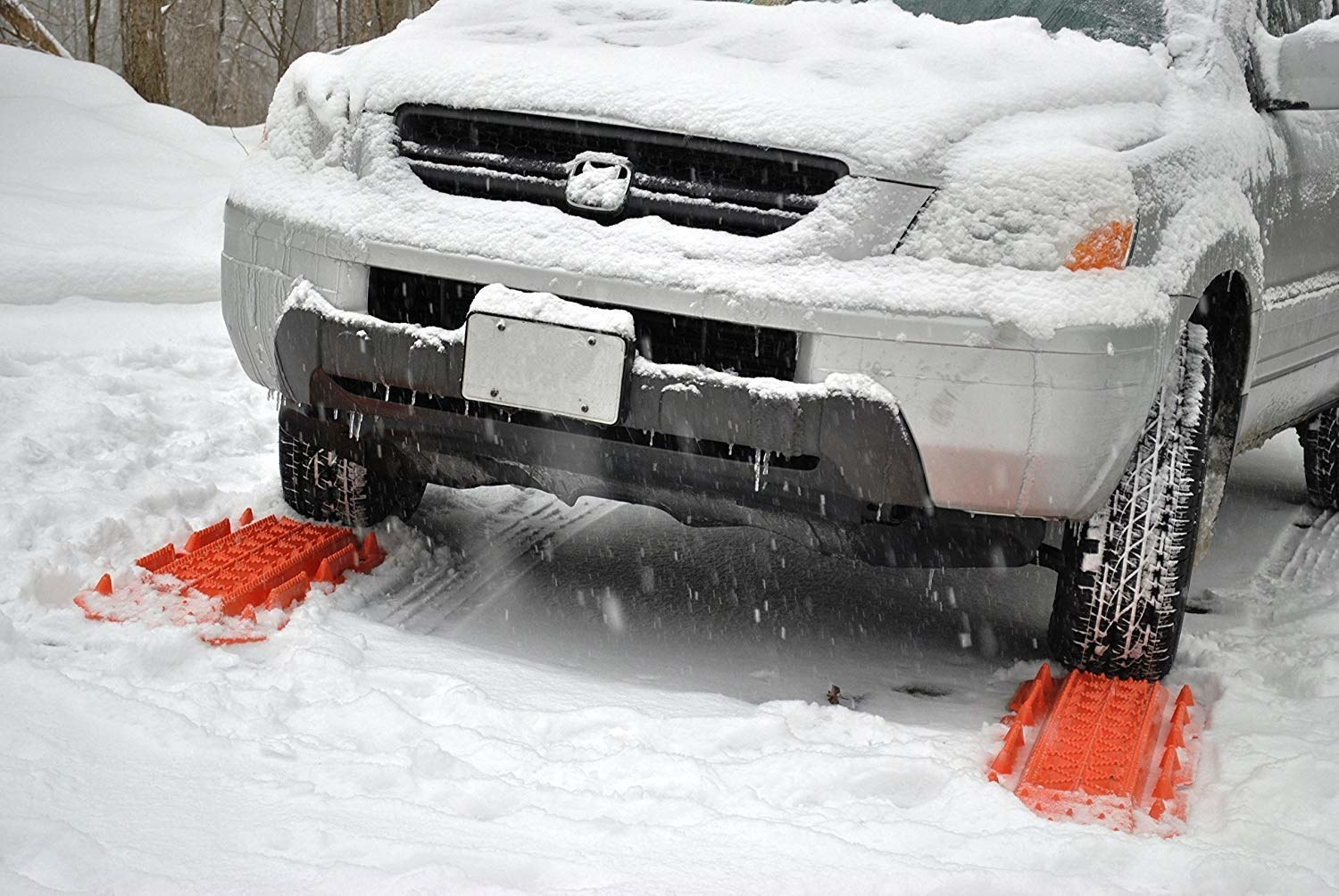 A car using the escape tracks in the snow